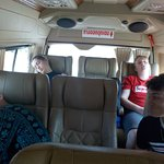 The spacious van and three tired travelers!