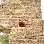 The hole admist the thick wall houses ceramic pipe for water movement in the palace.