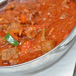 Sagla's Spris  Strips of tender Beef or Lamb sautéed in a well-balanced red Berbere sauce, onions, garlic and tomatoes.