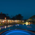 Lodge and pool area at night