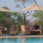 Relax and take in the atmosphere of Lilayi Lodge poolside