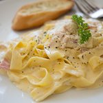 Ribbons of fresh tagliatelle, diced bacon and a warm cream and Parmesan sauce.  Comfort at it's best.