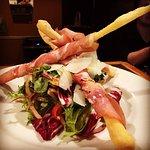 Prosciutto warped bread sticks on a salad special