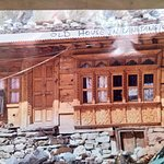 Old house that was covered by rocks in the earthquake. The lady owner survived because she was out working in the fields at that time.