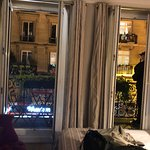 double french doors onto private balcony - with pretty real live red flowers.  Very FRENCH!  Loved it!  This is why we booked the hotel, and were impressed!