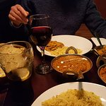 Butter chicken, dahl, aubergine , onion rice and garlic naan. The naan was freshly prepared and the rice was perfect
