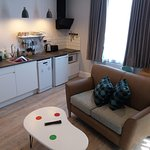 A typical living room with kitchenette, sofa and dining table