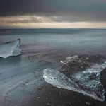 Glacial ice that washed up on the black sand beach