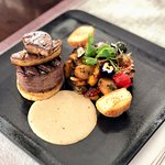 Tournedo rossini a la chef (aged Angus beef tenderloin with foie gras) served with new potatoes and vegetables