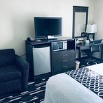All rooms include Premium High Speed WiFi, Lounge Chair, 100 Channels with HBO, Microwave, Mini-Fridges, Iron, Coffee Maker, and Desk Table.
