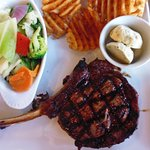 Rib Eye steak with cross-cut chips, vegetables, and blue cheese butter