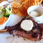 Rib Eye steak with cross-cut chips, vegetables, and blue cheese butter -- cooked medium