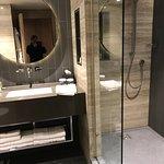 Very tidy bathrooms with plentiful toiletries