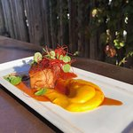 Sous-vide pork belly with butternut squash puree, maple glaze. chili threads and micro greens.