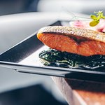Salmon with spinach, cream, black rice nad Grana Padano