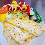 Grilled Plaice with butter and black pepper for a hearty healthy option with salad or half and half salad and chips.