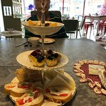 sandwiches and desserts served on tiered plate