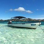 Our boat anchored on the sandbar