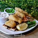 Roots & Co Local Beer Battered Fish Stack |  Served in rustic bread with chunky tartar sauce 20 Post Office Road 01202 558399