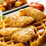 A photo of our Chicken and Waffles that you can enjoy during Brunch with us on Saturday's and Sundays!