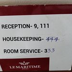 Incorrect and hand-written phone directory in the room