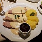 Kalbstafelspitz (veal slices) with Preiselbeeren (cranberries) and potatoes with horseradish sauce.