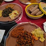 yummy lunch! On the bottom clockwise is Tibse, zuresh, doro wot. It is eaten with injera-sourdough bread without utensils.