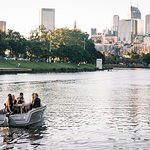 The skyline of Melbourne is the perfect backdrop as you enjoy food and drink on the Yarra River with friends.