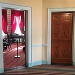 Glimpse of parlor.  Painted doors.