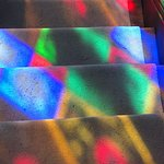 The colors coming in from the stained glass window on the stairs