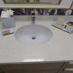 L'Occitane toiletries: soap, lotion, vanity kit, comb