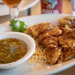 Fried Gulf oysters over rice