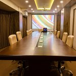 Conference Room: The conference room can seat upto 22 people, equipped with an overhead projector and a motorized electric auto projector screen