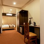 Executive Room: Spacious and Fully Air Condiitoned with Free wifi, room service, Electronic safe deposit Locker, hair Drier, Electric Kettle,Aromatherapy Toiletries,Iron with Iron Board,