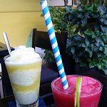 Frozen raspberry daiquiri and pineapple, honey and ginger fruit drink