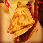 A quesadillas, a flour tortilla, filled, folded & toasted with Trealy Farm chorizowith crushed