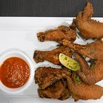 Chicken Wings marinated with Italian spices accompanied by Zazz spicy arrabiata sauce
