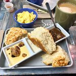 Biscuit flight with coffee and a side of scrambled eggs