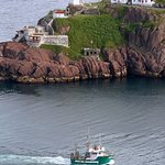 Fort Amherst - and a fishing boat entering St. John's Harbour. View from Signal Hill