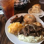 The mains (clockwise) -- fried chicken, glazed chicken, pepper steak (on mash), macaroni and che