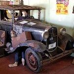 Travelers in a vintage car