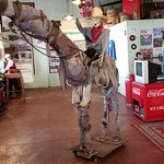 Statue of a man and horse made from junk.