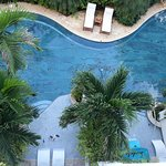 View of swim up rooms from balcony of Crystal Lagoon Club Level Luxury Honeymoon Suite with Balcony Tranquility Soaking Tub