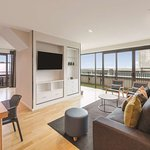 adina apartment hotel auckland two bedroom premier apartment lounge room V