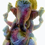 Little ancient sculpture of Lord Ganesh in a niche, in the patio