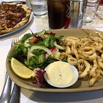 The calamari with the fresh and tasty salad. The calamari doesn't have a heavy coating of crumbi