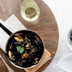 Steamed Mussels: shallot, parsley, white wine, cream, french fries.
