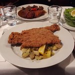 Schnitzel with parlsley potatoes and goulash with potatoe croquettes