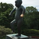 This is a famous statue. It is good luck to hold the child's hand.
