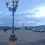 This is the actual Piazzale parking lot where the buses stop, with David standing there among th